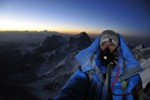 Peter Whittaker climbs towards the summit of Mt. Everest as a new day greets Nepal.